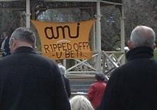 Kaiapoi redzone EQNZ protest, AMI banner - 250911